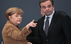 Germany's Chancellor Angela Merkel talks to Greece's Prime Minister Antonis Samaras as they arrive for a forum with Greek entrepreneurs in Athens