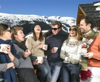 group-of-friends-on-terrace-at-mountains