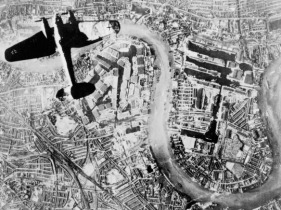 Luftwaffe Heinkel He 111 bomber flying over Wapping and the Isle of Dogs in the East End of London at at the start of the Luftwaffe's evening raids of 7 September 1940