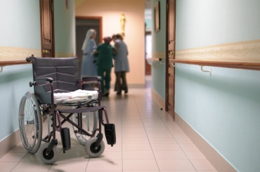 Wheelchair.  Wheelchair in a corridor of the house for older persons.