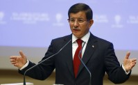 Davutoglu speaks during a meeting at his ruling AK Party headquarters in Ankara
